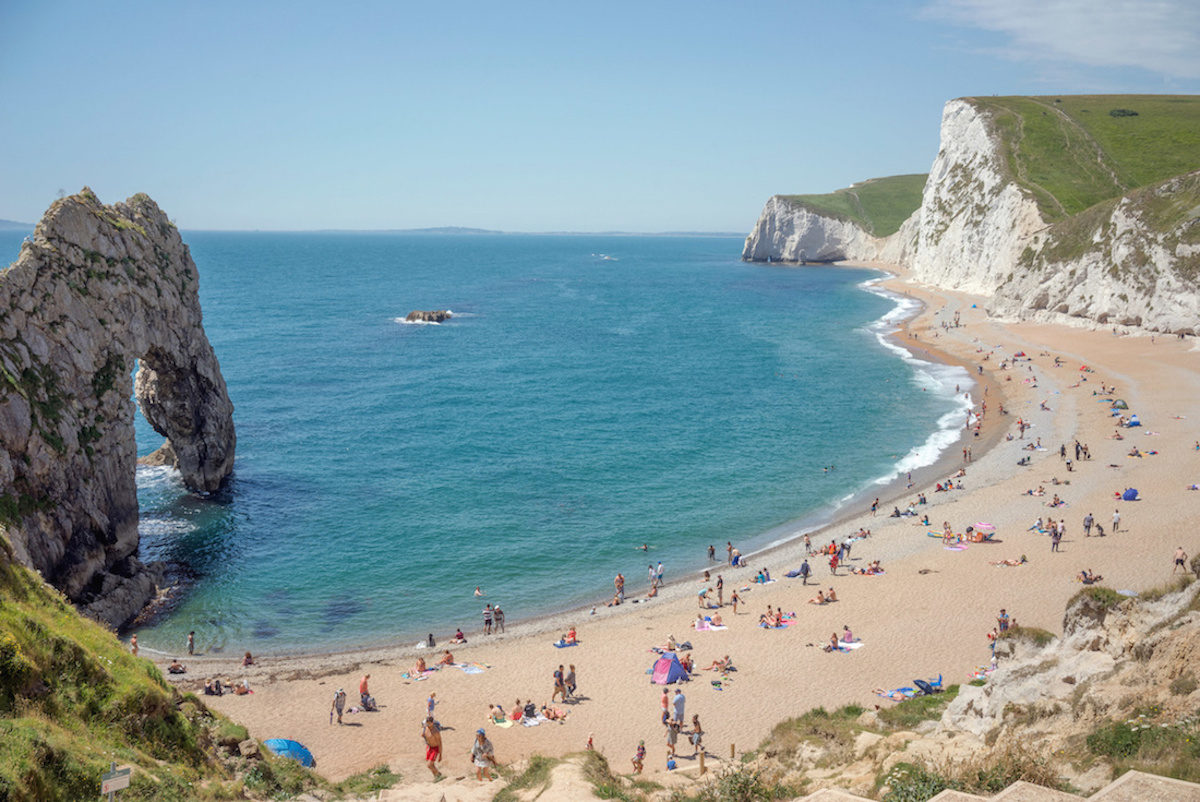 Durdle door beach in Dorset, UK on a sunny summer's day