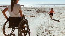 Woman and Child On Wheelchair Accessible Beach
