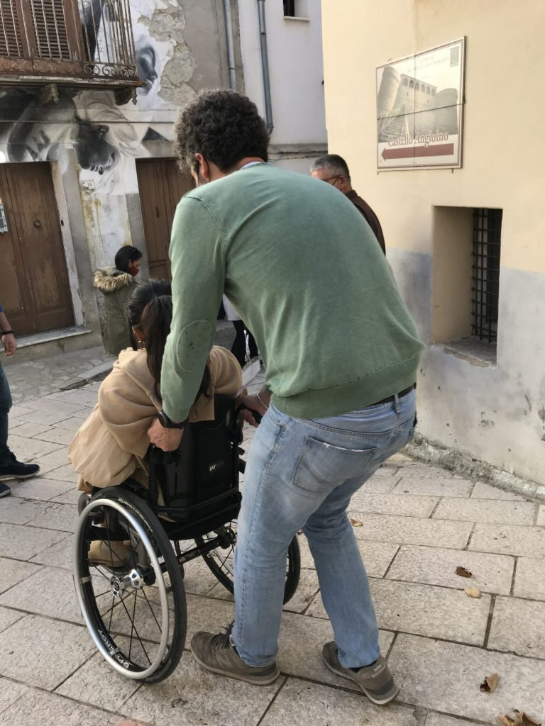 Wheelchair User And Assistant In Molise