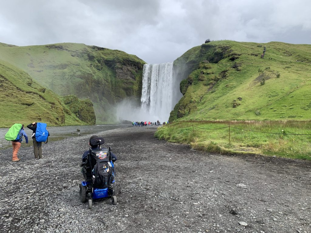 Cory And A Waterfall In Iceland