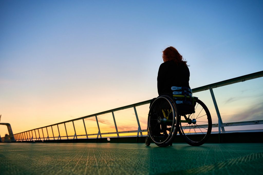Wheelchair User On Cruise Deck At Sunset