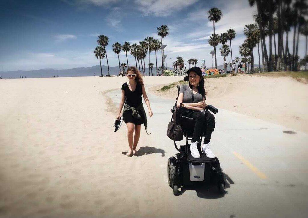 Maayan On The Beach In Her Wheelchair